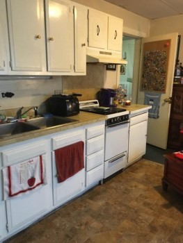 7 Otsego Street kitchen with stove toaster and coffeemaker