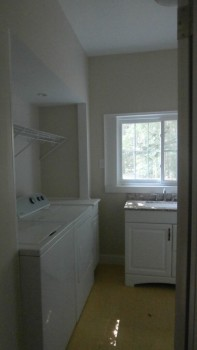 Laundry room with half bath